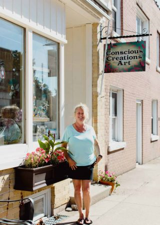 CINDY PEARCE outside her store